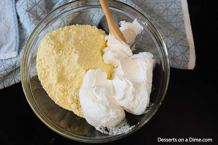 Lemon cake mix cookies are delicious and you only need 4 ingredients for this easy recipe. They are so light and fluffy and the cake mix makes it so easy.