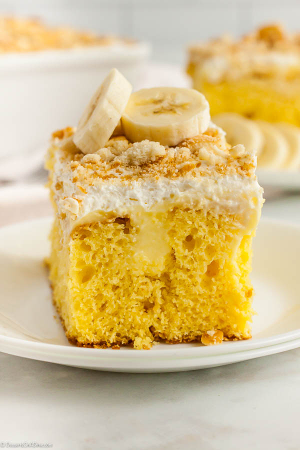 Banana Pudding Poke Cake Recipe has everything you love about banana pudding in a delicious cake. This is the easiest pudding poke cake and so tasty.