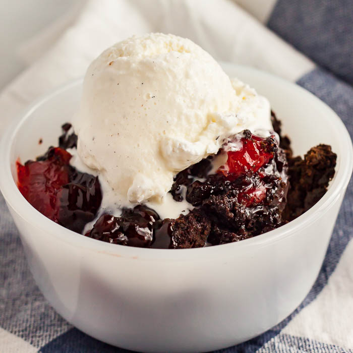 Chocolate Cherry Dump Cake Recipe is the easiest dessert ever and so decadent. Try this 3 ingredient cherry dump cake today for a super easy recipe.