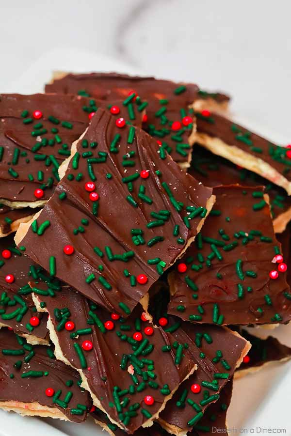 Your entire family will devour this easy Christmas Crack recipe. This Christmas cracker toffee recipe is ready in under 30 minutes since it's made with saltines and is the perfect candy for the holidays.