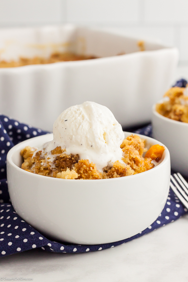 With only 4 ingredients, this Peach Dump Cake Recipe is super easy to make but tastes just like Grandma's peach cobbler. Try this for a quick dessert today.