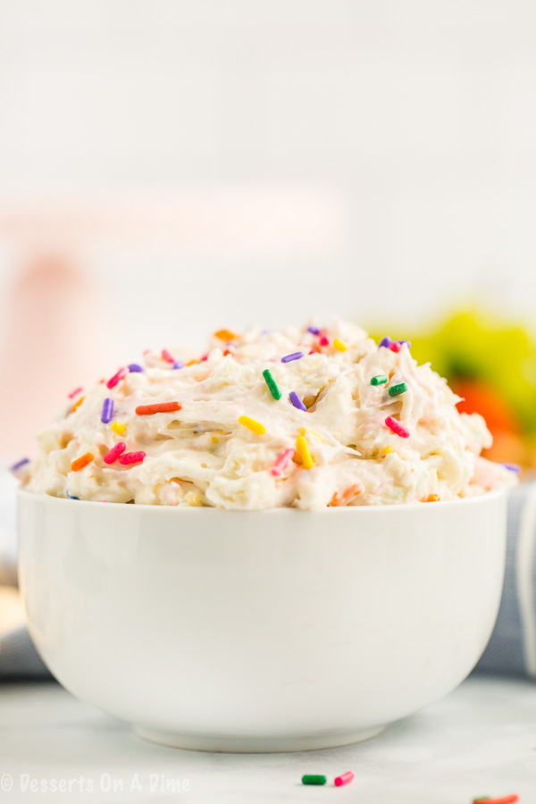 You only need 4 ingredients to make this decadent Cake Batter Dip Recipe. Serve it with fruit, graham crackers or anything you like for an amazing treat.