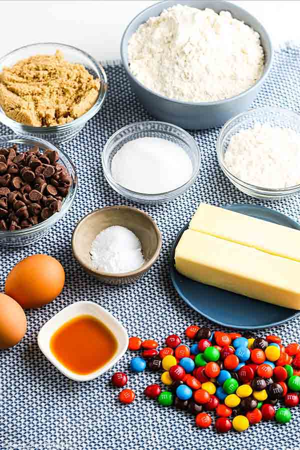 This M&M Cookies Recipe is amazing and you can make them from scratch easily. Each bite is bursting with chocolate chips and m&m's candy for a great treat.