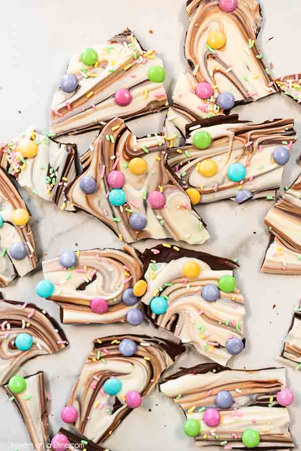 Easter chocolate bark recipe is so tasty and looks pretty with swirls of chocolate. Let the kids help decorate with sprinkles and candy for the best treat.