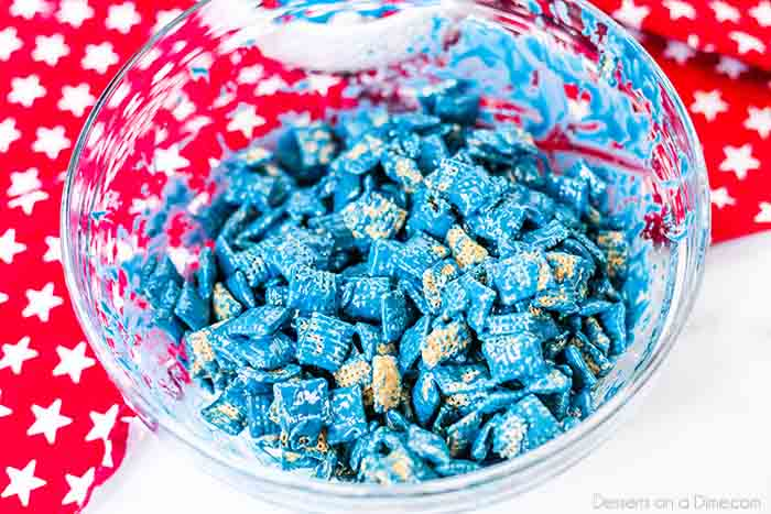 4th of July puppy chow recipe is a simple patriotic treat perfect to make for fourth of July or Memorial Day. Everyone will love patriotic puppy chow!