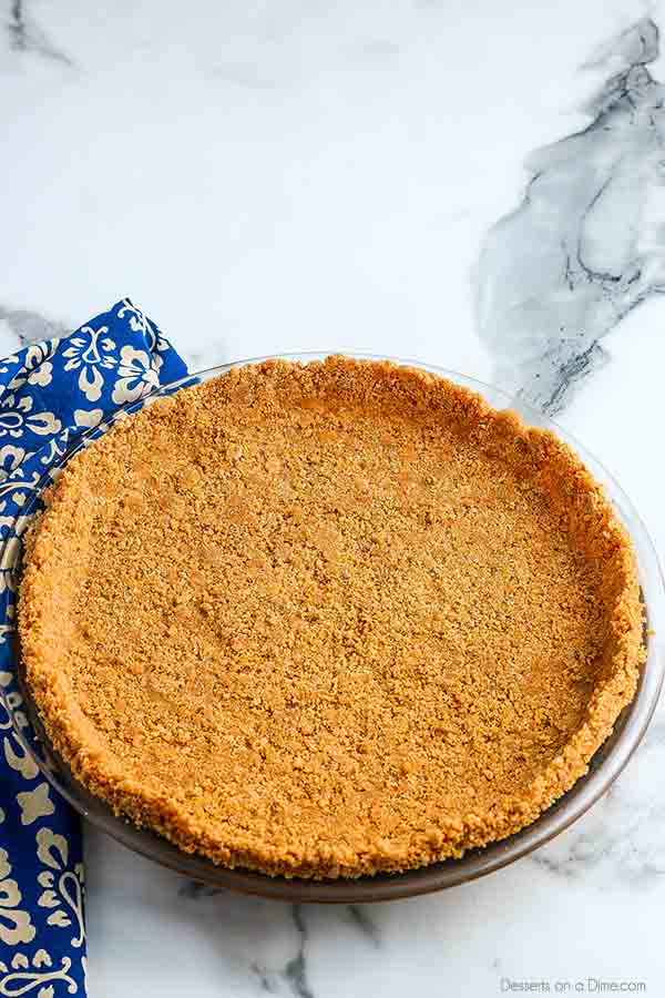 We are going to show you how to make graham cracker crust that is super easy. Skip those store bought pie crusts and make this in minutes at home.