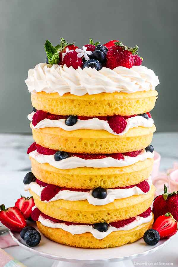 Lemon Cake Recipe is light and fluffy with endless layers. This is the perfect cake for Spring or Summer with all of the lemon flavor and fresh berries.