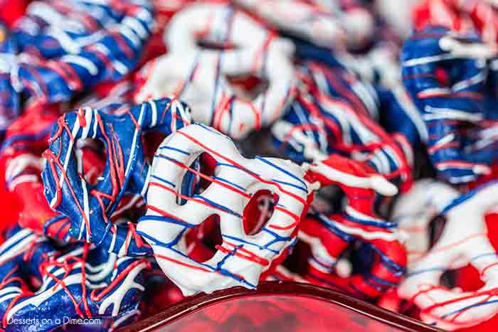 Celebrate the 4th of July with these festive and tasty Red white and blue chocolate covered pretzels. They are easy to make, inexpensive and so colorful.