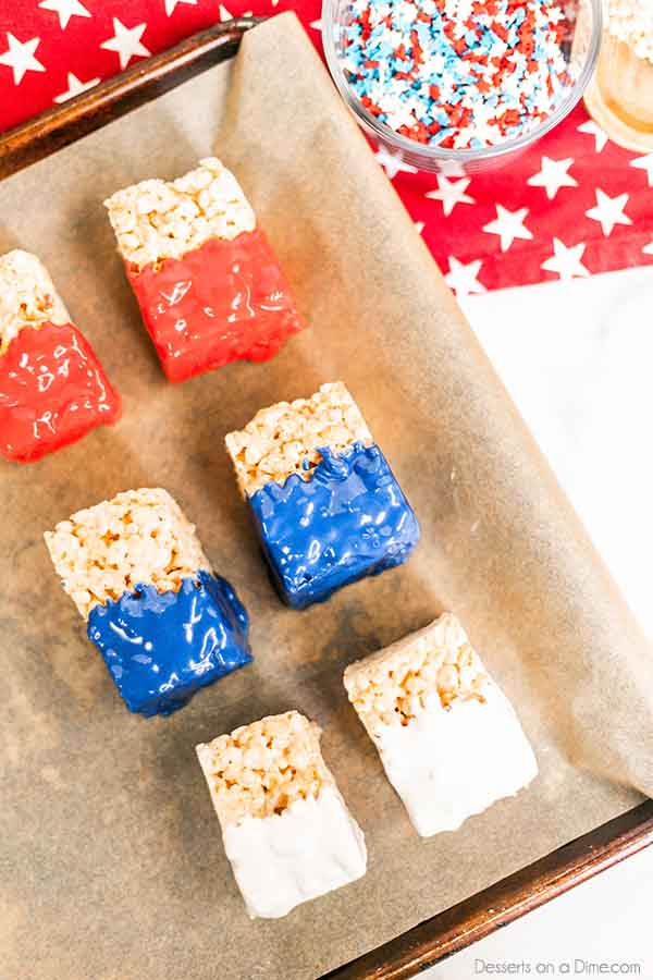 Try 4th of July chocolate dipped rice krispie treats for a tasty and patriotic recipe. We love to make red white and blue treats for July 4th and more.